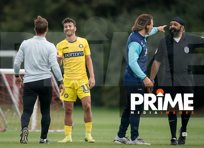 Scott Kashket of Wycombe Wanderers & Brentford B coach Sam Saunders during the behind closed doors friendly between Brentford B and Wycombe Wanderers at Brentford Football Club Training Ground & Academy, 100 Jersey Road, TW5 0TP, United Kingdom on 3 September 2019. Photo by Andy Rowland.