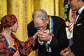 Comedian David Letterman kisses the hand of ballerina Natalia Makarova (L) as President Barack Obama (R) looks on at the Kennedy Center Honors reception at the White House on December 2, 2012 in Washington, DC. The Kennedy Center Honors recognized seven individuals - Buddy Guy, Dustin Hoffman, David Letterman, Natalia Makarova, John Paul Jones, Jimmy Page, and Robert Plant - for their lifetime contributions to American culture through the performing arts. .Credit: Brendan Hoffman / Pool via CNP