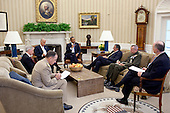 United States President Barack Obama and U.S. Vice President Joe Biden meet with, clockwise from the President, Defense Secretary Leon Panetta, Lieutenant General John Allen, National Security Advisor Tom Donilon, Chairman of the Joint Chiefs of Staff Admiral Mike Mullen, and United States Ambassador to Afghanistan Ryan Crocker, in the Oval Office, July 5, 2011. .Mandatory Credit: Pete Souza - White House via CNP