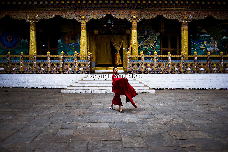 A Buddhist monks is seen outside the prayer hall at the ancient Punakha Dzong (fortress) in Punakha, Bhutan.Phunakha was the capital of Bhutan and the seat of government until 1955, when the capital was moved to Thimphu. Punakha is the administrative centre of Punakha dzongkhag, one of the 20 districts of Bhutan. Photo: Sanjit Das/Panos