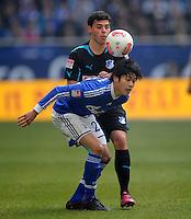 FUSSBALL   1. BUNDESLIGA   SAISON 2012/2013    27. SPIELTAG FC Schalke 04 - TSG 1899 Hoffenheim                       30.03.2013 Atsuto Uchida (li, FC Schalke 04) gegen Kevin Volland (re, TSG 1899 Hoffenheim)