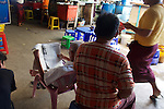Reading Newspaper, Gyee Zai Market