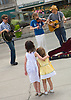 July 16, 2005: Sisters Cassie Goldstein, 5, left, and Alana Goldstein, 2, right, listen to the band, Back Off The Hammer, as they perform on Michigan Avenue in the heart of downtown Chicago. Photo by Kevin J. Miyazaki/Redux for The New York Times