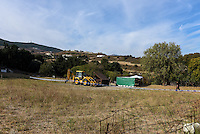 "Pictured: A digger next tos a forensics tent in a field in Kos, Greece. Monday 26 September 2016<br /> Re: Police teams searching for missing toddler Ben Needham on the Greek island of Kos have said they are ""optimistic"" about new excavation work.<br /> Ben, from Sheffield, was 21 months old when he disappeared on 24 July 1991 during a family holiday.<br /> Digging has begun at a new site after a fresh line of inquiry suggested he could have been crushed by a digger.<br /> South Yorkshire Police (SYP) said it continued to keep an ""open mind"" about what happened to Ben."