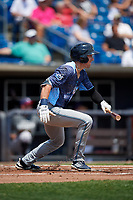 West Michigan Whitecaps center fielder Brock Deatherage (19) follows through on a swing during a game against the Quad Cities River Bandits on July 23, 2018 at Modern Woodmen Park in Davenport, Iowa.  Quad Cities defeated West Michigan 7-4.  (Mike Janes/Four Seam Images)