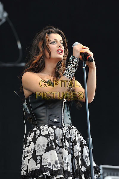 Bebe Rexha of Black Cards .Performing live at Hard Rock Calling, Hyde Park London, England, UK, .June 25th 2011..music festival concert gig on stage half length microphone singing black white skull print dress bracelets  leather zip corset top skirt bustier .CAP/MAR.© Martin Harris/Capital Pictures.