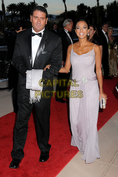 GUEST & EVA LaRUE .Palm Springs International Film Festival Awards Gala 2010 held at the Palm Springs Convention Center, Palm Springs, California, USA, .5th January 2010..full length purple lilac long print printed maxi dress brooch silver clutch bag La Rue belt sash sleeveless .CAP/ADM/BP.©Byron Purvis/AdMedia/Capital Pictures.