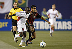 2 October 2004: Freddy Adu (left) and Amado Guevara (right) challenge for the ball in the first half. DC United defeated the MetroStars 1-0 at Giants Stadium in East Rutherford, NJ during a regular season Major League Soccer game..