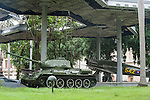 Havana, Cuba; vehicles used in the revolution surround the Granma Memorial which houses the vessel that brought Fidel Castro and his revolutionaries from Mexico to Cuba in 1956, the grounds are guarded 24 hours a day by armed soldiers