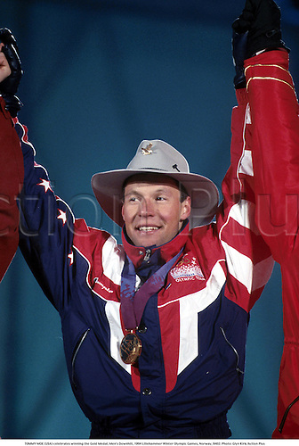 TOMMY MOE (USA) celebrates winning the Gold Medal, Men's Downhill, 1994 Lillehammer Winter Olympic Games, Norway, 9402. Photo: Glyn Kirk/Action Plus...skiing.wintersports.1994.Olympics.portrait.winter sport.winter sports.wintersport.wintersports.alpine.ski.skier.man