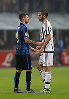 Calcio, Serie A: Inter vs Juventus. Milano, stadio San Siro, 18 ottobre 2015. <br /> FC Inter's Mauro Icardi, left, greets Leonardo Bonucci at the end of the Italian Serie A football match between FC Inter and Juventus, at Milan's San Siro stadium, 18 October 2015. The game ended 0-0.<br /> UPDATE IMAGES PRESS/Isabella Bonotto