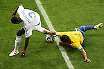 01 July 2006: Cafu (BRA) (2) grabs a handful of Eric Abidal's (FRA) (3) jersey to keep him from taking the ball upfield. France defeated Brazil 1-0 at Commerzbank Arena in Frankfurt, Germany in match 60, a Quarterfinal game of the 2006 FIFA World Cup.