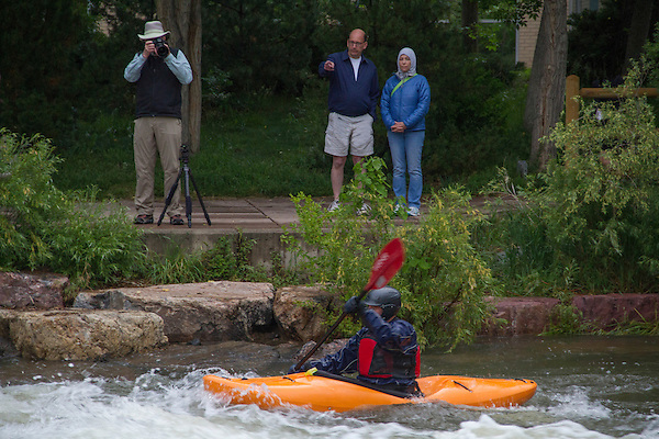 Photographer and kayaker in Clear Creek, Golden, Colorado,