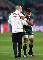 England Rugby Head Coach Eddie Jones embraces Will Genia of Australia during the pre-match warm-up. Old Mutual Wealth Series International match between England and Australia on November 18, 2017 at Twickenham Stadium in London, England. Photo by: Patrick Khachfe / Onside Images