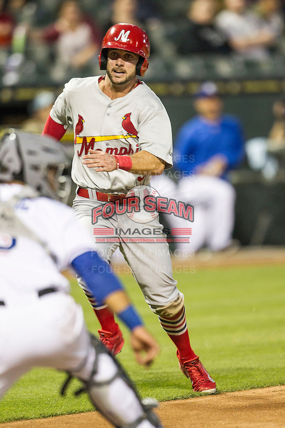 Memphis Redbirds second baseman Greg Garcia (5) prepare to slide home during Pacific Coast League game against the Round Rock Express on April 21, 2015 at the Dell Diamond in Round Rock, Texas. Round Rock defeated Memphis 2-1. (Andrew Woolley/Four Seam Images)