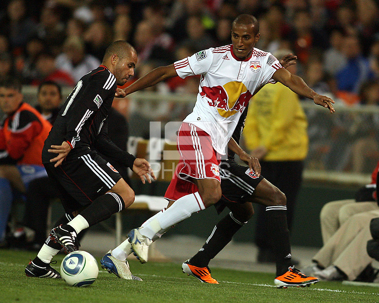 Fred (27) of D.C. United  dribbles past Roy Miller (7) of the New York Red Bulls during an MLS match at RFK Stadium, in Washington D.C. on April 21 2011. Red Bulls won 4-0.
