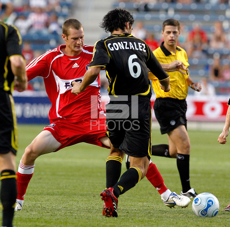 Chicago Fire forward Nate Jaqua (11) tries to knock the ball away from Columbus Crew defender Marcos Gonzalez (6).  The Chicago Fire tied the Columbus Crew 0-0 at Toyota Park in Bridgeview, IL on July 29, 2006.