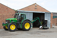 John Deere tractor and hedge cutter outside of a farm workshop<br /> ©Tim Scrivener Photographer 07850 303986<br />      ....Covering Agriculture In The UK....