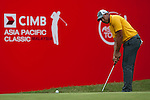 Jhonattan Vegas in action on the eighteenth green at the end of Round 2 of the CIMB Asia Pacific Classic 2011.  Photo © Andy Jones / PSI for Carbon Worldwide
