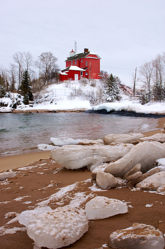 The bright red lighthouse on the shores of Lake Superior in Marquette, MI.