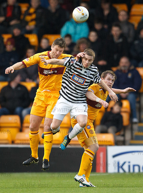 Ian Watt keeps close company with Motherwell defenders Stephen Craigan and Stevie Hammell
