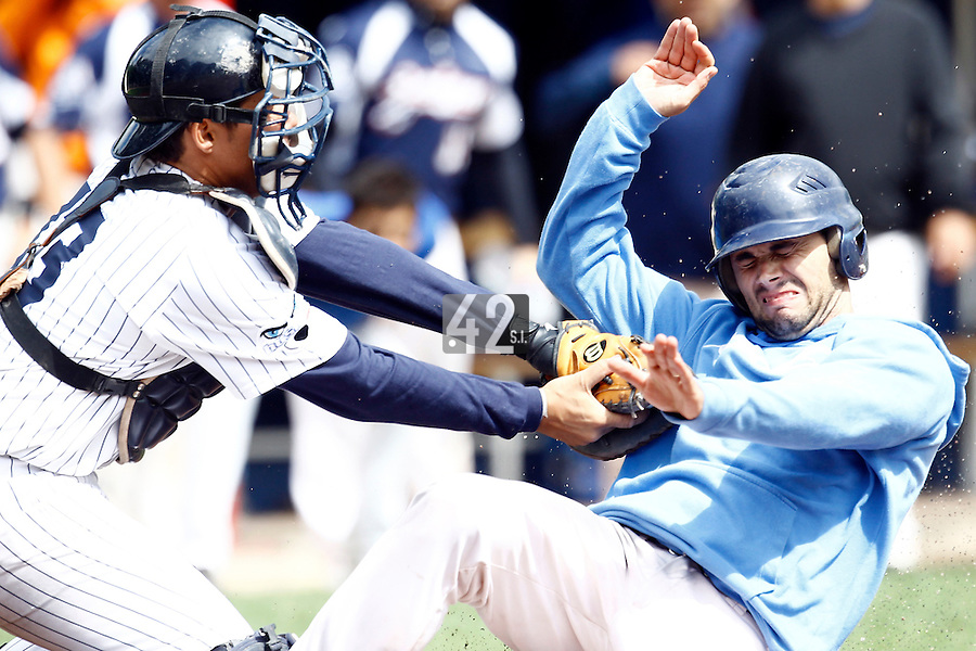17 July 2011: Jerome Dussart of the Savigny Lions is out at the plate by Boris Marche of the Rouen Huskies during the 2011Challenge de France final match won 6-4 by the Rouen Huskies over the Savigny Lions, at Stade Pierre Rolland, in Rouen, France.