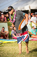 Waimea Bay, North Shore of Oahu, Hawaii.  December 4 2014) Clyde Aikau (HAW). - The Opening Ceremony of the 2014 Quiksilver In Memory of Eddie Aikau contest was held this afternoon in the park at Waimea Bay. This winter, the big wave riding event celebrates a special milestone of 30 years. <br /> The Quiksilver In Memory of Eddie Aikau is a one-day big wave riding event that only takes place if and when waves meet a 20-foot minimum height, during the holding period of December 1 through February 28, each Hawaiian winter. The official Opening Ceremony with the Aikau Family will be held on Thursday, December 4th, 3pm, at Waimea Bay.<br />  <br /> &quot;The Eddie&quot; is the original big wave riding event and stands as the measure for every big wave event that exists in the world today. It has become an icon of surfing through its honor, integrity and rarity.<br />  <br /> The event honors Hawaiian hero Eddie Aikau, whose legacy is the respect he held for the ocean; his concern for the safety of all who entered it on his watch; and the way with which he rode Waimea Bay on its most giant and memorable days. <br />  <br /> Adherence to strict wave height standards has ensured its integrity; it is only held on days when waves meet or exceed the Hawaiian 20-foot minimum (wave face heights of approximately 40 feet). This was the threshold at which Eddie enjoyed to ride the Bay. It has been said that what makes The Eddie special is the times it doesn't run, because that is precisely its guarantee of integrity and quality days of giant surf.<br />  <br /> The competition has only been held a total of 8 times: it's inaugural year at Sunset Beach, and then seven more times at its permanent home of Waimea Bay. The Eddie was last held on December 9, 2009, won by California's Greg Long.   Photo: joliphotos.com