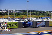 Sept. 18, 2010; Concord, NC, USA; A nearby housing development can be seen behind a sound wall barrier alongside the track during qualifying for the O'Reilly Auto Parts NHRA Nationals at zMax Dragway. Mandatory Credit: Mark J. Rebilas /