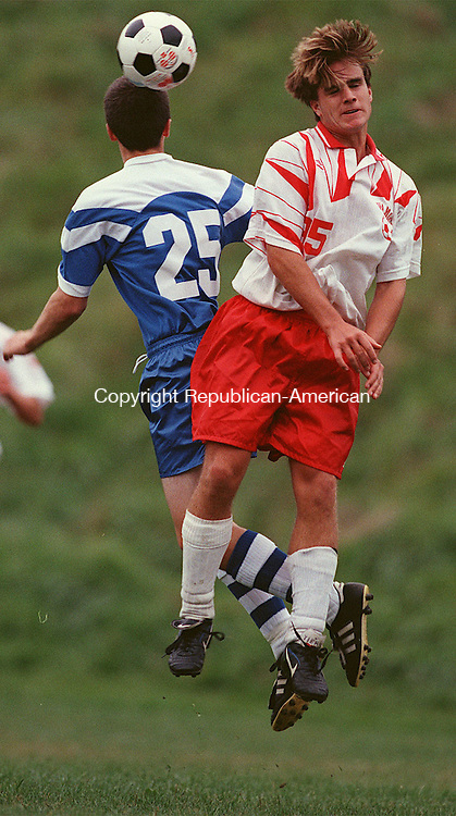 LITCHFIELD, CT 09/25/98--0925CA04.tif   #25 Condor Taff from Nonnewaug, battles for the ball against #35 Spencer Tanner from Wamogo, during a soccer game at Wamogo Regional High School.--CRAIG AMBROSIO staff  / STAND ALONE PHOTO  (Filed in Scans/Scan-In)