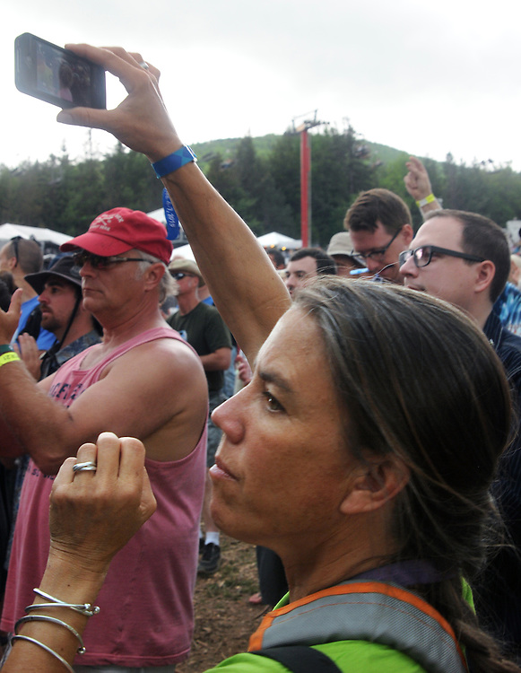 Professional Photographer, Tania Barricklo, seen on the job covering the audience watching a performance of, The Mother Hips, at Mountain Jam Music Festival of 2015, in Hunter, NY on Friday June 5, 2015. Photo by Jim Peppler. Copyright Jim Peppler 2015.