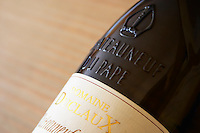 bottle with moulded relief on the neck domaine duclaux chateauneuf du pape rhone france