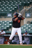 GCL Orioles designated hitter Carlos Diaz (14) at bat during the first game of a doubleheader against the GCL Rays on August 1, 2015 at the Ed Smith Stadium in Sarasota, Florida.  GCL Orioles defeated the GCL Rays 2-0.  (Mike Janes/Four Seam Images)
