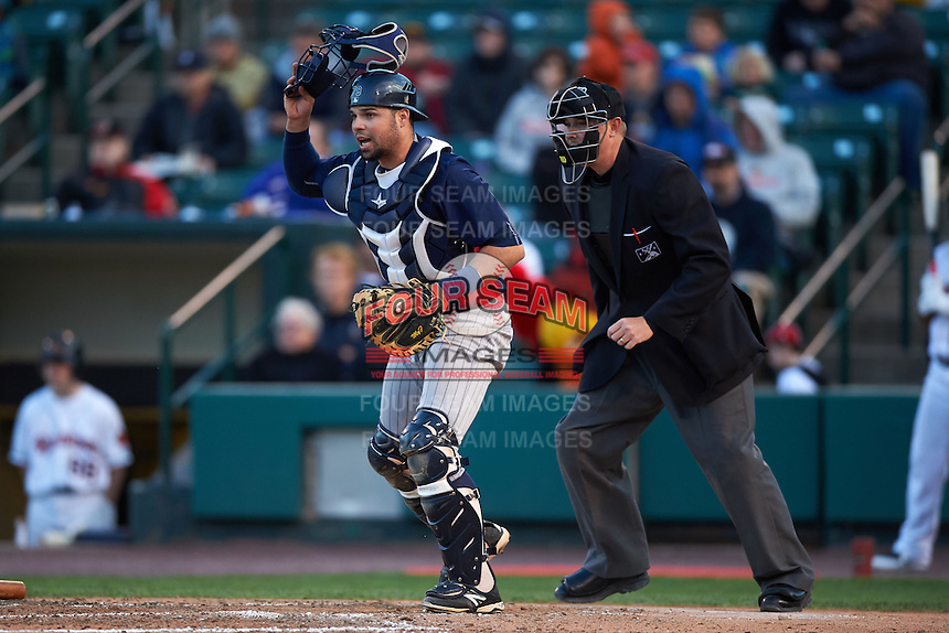 Toledo Mudhens catcher Manny Pina (9) and umpire Chad Whitson during a game against the Rochester Red Wings on May 12, 2015 at Frontier Field in Rochester, New York.  Toledo defeated Rochester 8-0.  (Mike Janes/Four Seam Images)