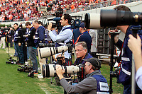 CHARLOTTESVILLE, VA- NOVEMBER 12: Photographers shoot the   Virginia Tech vs. Virginia Cavaliers ACC football game on November 28, 2011 at Scott Stadium in Charlottesville, Virginia. Virginia Tech defeated Virginia 38-0. (Photo by Andrew Shurtleff/Getty Images) *** Local Caption ***