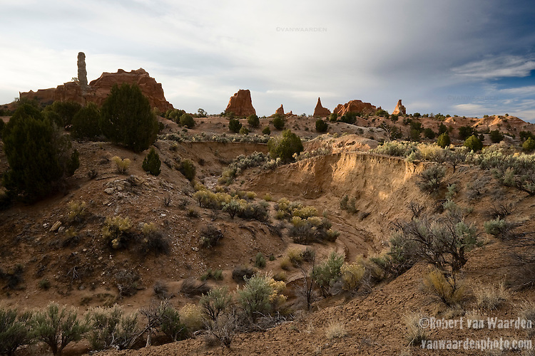 A dry river bed winds through Kodachrome State Park while hoodoos and rock formations form the background