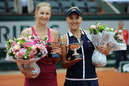 09.06.2013 Paris, France. Elena Vesnina of Russia and Ekaterina Makarova of Russia hold their individual Winners trophies after the match against Sara Errani of Italy and Roberta Vinci of Italy in the Women's Doubles Final of the French Open from Roland Garros.
