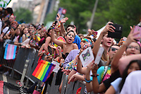 Washington, DC - June 10, 2018:  People dance and sing as they listen to a performer at the 2018 Capitol Pride concert in Washington, D.C. June 10, 2018.  (Photo by Don Baxter/Media Images International)