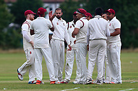 Parkonians celebrate the third Hainault wicket during Hainault and Clayhall CC (batting) vs Oakfield Parkonians CC, Shepherd Neame Essex League Cricket at the Jack Carter Pavilion on 15th July 2017