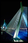 "The Zakim Bridge is a cable-stayed bridge that crosses the Charles River in Boston Massachusetts, USA.  Completed in 2003, the bridge is the widest cable stayed bridge in the world it carries ten lanes of traffic over the Charles River.  The Bridge was built as part of the ""big Dig"" project the largest highway construction project in the USA."