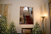 "The 2017 White House Christmas decorations, with the theme ""Time-Honored Traditions,"" which were personally selected by first lady Melania Trump, are previewed for the press in Washington, DC on Monday, November 27, 2017.  This is a view looking up the Grand Staircase going to the Residence.<br /> Credit: Ron Sachs / CNP"