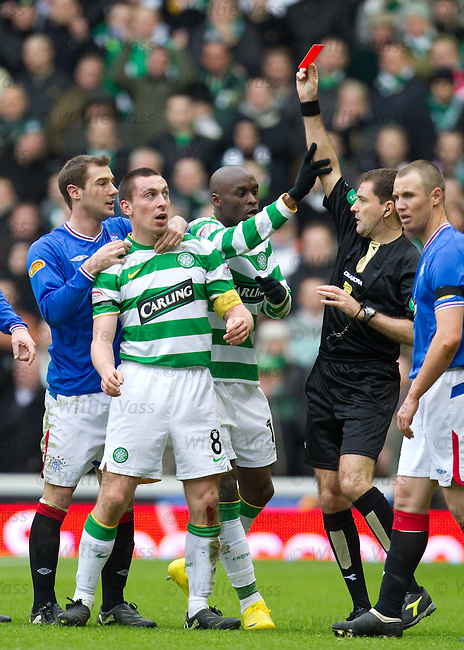 Scott Brown clashes with Kyle Lafferty and is shown a straight red card
