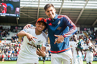 ( L-R ) Jefferson Montero of Swansea City  and Federico Fernandez of Swansea City  on the pitch with team players and staff during a lap of honour after the Barclays Premier League match between Swansea City and Manchester City played at the Liberty Stadium, Swansea on the 15th of May  2016