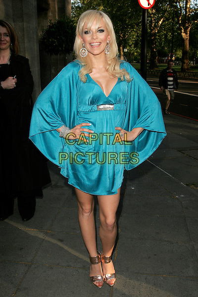 SEPTEMBER (Petra Eos Marklund).The Sony Radio Academy Awards 2009, Grosvenor House Hotel, Park Lane, London, England..May 11th, 2009.full length blue silk satin dress sleeves silver bracelet artist hands gold sandals on hips cleavage .CAP/AH.©Adam Houghton/Capital Pictures.