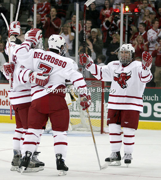 Nebraska-Omaha's Phil Angell (No. 4), Ed Del Grosso (No. 7) and Jeric Agosta (right) celebrate a goal. The No. 19 Nebraska-Omaha Mavericks beat Niagara 10-1 in the opening round of the Mutual of Omaha Stampede on Oct. 20, 2006. (Photo by Michelle Bishop)
