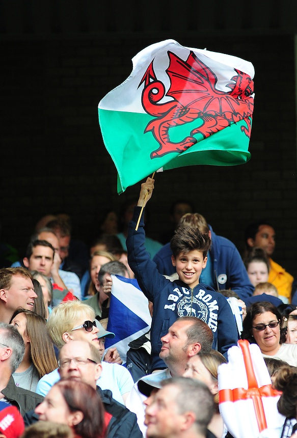 A young Wales fan waves a Welsh flag<br /> <br /> Australia Vs Wales - Men's quarter-final<br /> <br /> Photographer Chris Vaughan/CameraSport<br /> <br /> 20th Commonwealth Games - Day 4 - Sunday 27th July 2014 - Rugby Sevens - Ibrox Stadium - Glasgow - UK<br /> <br /> &copy; CameraSport - 43 Linden Ave. Countesthorpe. Leicester. England. LE8 5PG - Tel: +44 (0) 116 277 4147 - admin@camerasport.com - www.camerasport.com