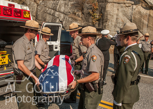 Yosemite National Park, CA—Dog Rock Fire—Yosemite National Park Rangers  transfer the body of the Cal Fire pilot killed in an airplane crash in Yosemite National Park on Tuesday, October 7. The formal ceremony included the Cal Fire Honor Guard and marked the transition  from Yosemite National Park to Cal Fire. The ceremony was conducted at the entrance to Yosemite on Highway 140 near El Portal, CA, today Wednesday, October 08, 2014. (AP Photo/Al Golub)