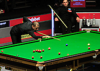 Barry Hawkins pots a blue ball during the Dafabet Masters FINAL between Barry Hawkins and Ronnie O'Sullivan at Alexandra Palace, London, England on 17 January 2016. Photo by Liam Smith / PRiME Media Images