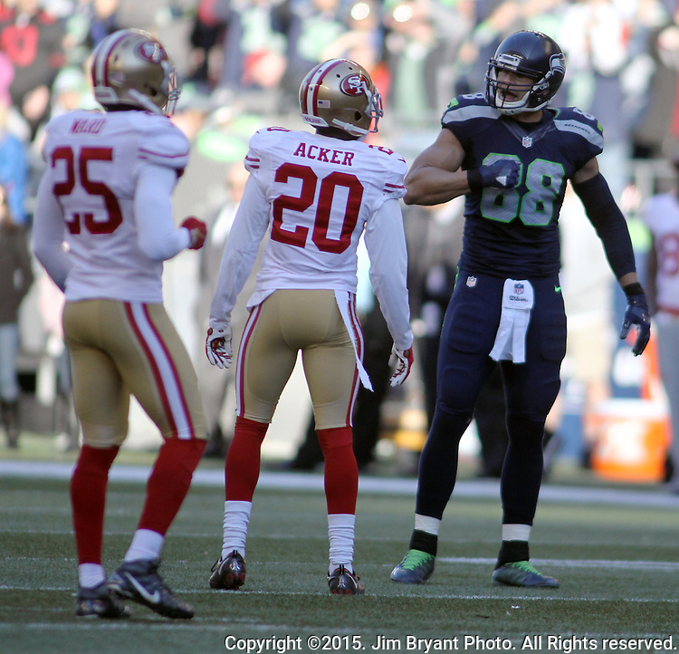 Seattle Seahawks tight end Jimmy Graham (88) hits his chest after catching a pass for first down against San Francisco 49ers cornerbacks Kenneth Acker (20) and Jimmy Ward (25) at CenturyLink Field in Seattle, Washington on November 22, 2015.  The Seahawks beat the 49ers 29-13.   ©2015. Jim Bryant Photo. All RIghts Reserved.