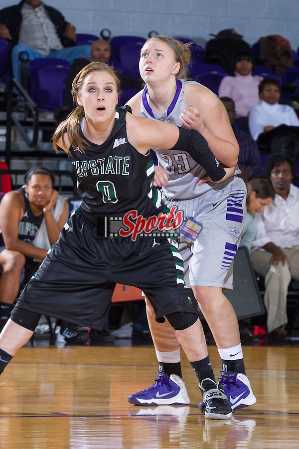 Lauren Bogle (0) of the USC Upstate Spartans boxes out Teddy Vincent (23) of the High Point Panthers at Millis Athletic Center on November 13, 2013 in High Point, North Carolina.  The Panthers defeated the Spartans 75-69.   (Brian Westerholt/Sports On Film)