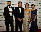 Lionel Richie, second left, arrives with son Miles, left, and girlfriend Lisa Parigi, second right, and sister Deborah Richie, right, for the formal Artist's Dinner honoring the recipients of the 40th Annual Kennedy Center Honors hosted by United States Secretary of State Rex Tillerson at the US Department of State in Washington, D.C. on Saturday, December 2, 2017. The 2017 honorees are: American dancer and choreographer Carmen de Lavallade; Cuban American singer-songwriter and actress Gloria Estefan; American hip hop artist and entertainment icon LL COOL J; American television writer and producer Norman Lear; and American musician and record producer Lionel Richie.  <br /> Credit: Ron Sachs / Pool via CNP